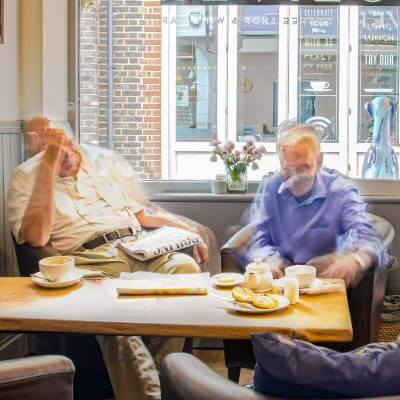 An image of patrons at Olivers Coffee Shop